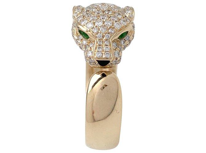 """Bagues Cartier Bague Cartier modèle """"Panthère"""" en or jaune, onyx, émeraudes et diamants. Autre,Or jaune Autre ref.167380"""