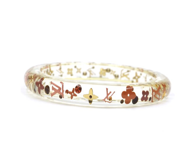 Bracelets Louis Vuitton Louis Vuitton - Bracelet jonc à logo transparent avec inclusion de fleurs Plastique Autre ref.167847