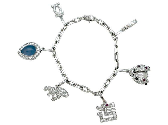 Bracelets Bracelet Cartier en or blanc, 6 breloques, calcédoine, diamants, émeraudes et rubis. Or Autre ref.168763