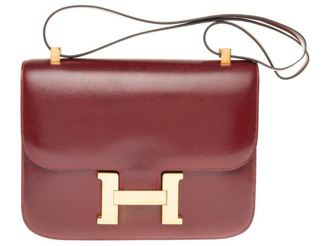 Sacs à main Hermès Hermès Constance 23 en cuir box bordeaux, garniture en métal plaqué or en excellent état ! Cuir Bordeaux ref.169170
