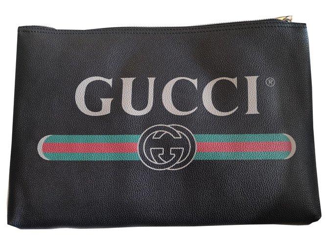 Pochettes Gucci Pochette modèle Imprimé cuir ners Cuir Noir ref.170148