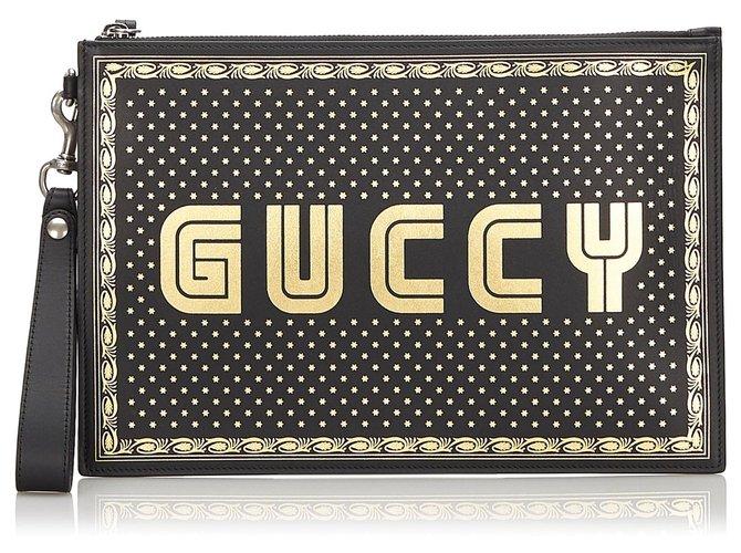 Pochettes Gucci Pochette noire Guccy Moon and Stars Gucci Cuir,Veau façon poulain Noir,Doré ref.172274