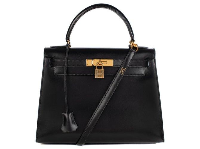 Sacs à main Hermès Hermès Kelly 28cm sellier avec bandoulière en cuir box noir, garniture en métal plaqué or, en excellent état Cuir Noir ref.174421
