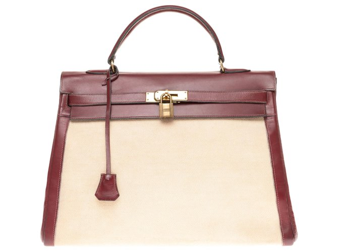 Hermès hermes kelly 35 bi-material in beige canvas and burgundy box leather, gold plated metal trim Handbags Leather,Cloth Beige,Dark red ref.174580