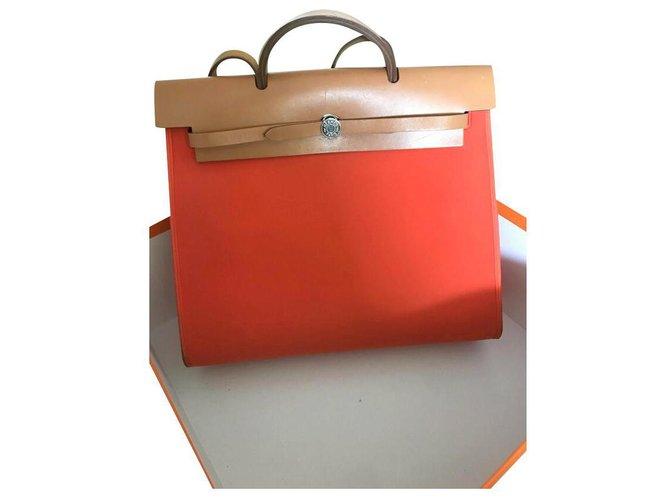 Hermès Handbags Handbags Leather,Cloth Orange ref.174712