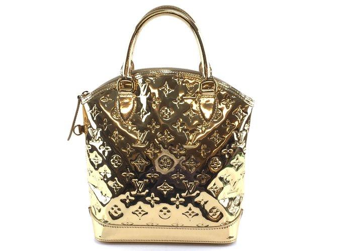 Louis Vuitton Louis Vuitton Lockit Vertical PM Gold Pvc Handbags Patent leather Golden ref.176835