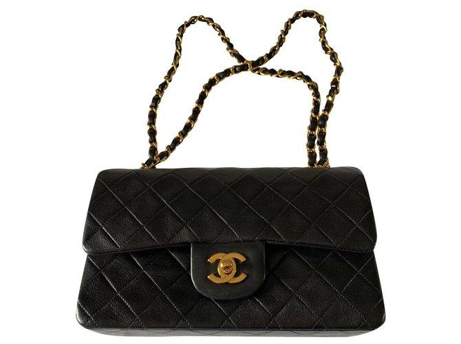Sacs à main Chanel Sac à rabat doublé intemporel Chanel Cuir Noir ref.178881