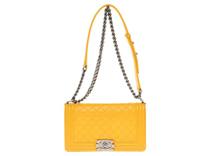 Chanel Chanel Boy old medium (25cm) in yellow buttoned quilted leather and hardware in aged silver metal Handbags Leather Yellow ref.179796