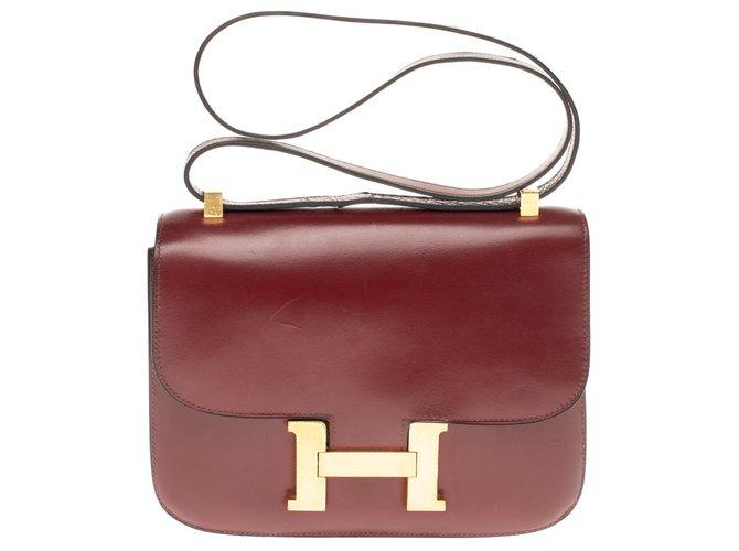 Sacs à main Hermès Hermès Constance 23 en cuir box bordeaux, garniture en métal plaqué or en très bon état Cuir Bordeaux ref.180136