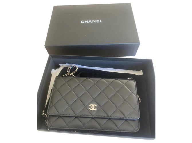 Chanel Chanel Wallet on Chain shoulder bag in black quilted leather Handbags Leather Black ref.203493