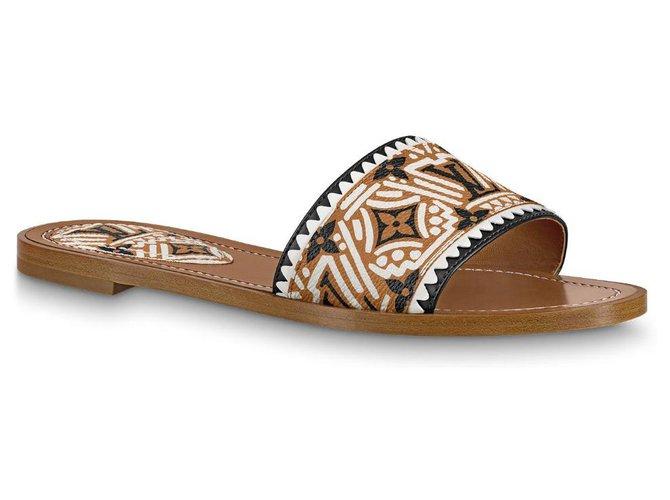 Louis Vuitton LV cognac colour Crafty Mules Sandals Leather Beige ref.208094