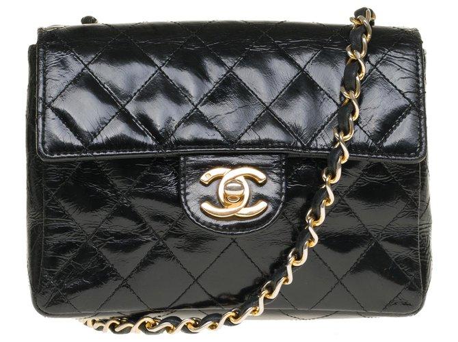 Chanel Lovely Chanel Mini Timeless bag in black patent quilted, garniture en métal doré Handbags Patent leather Black ref.242403