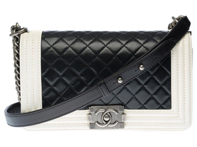 Chanel Two-tone old medium boy in black quilted leather with white leather outline, Aged silver metal trim Handbags Leather Black,White ref.277583