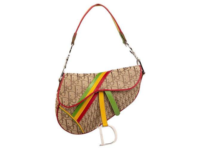 Christian Dior Handbags Beige Cloth  ref.293067