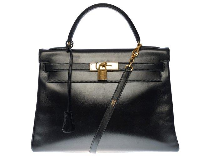 Hermès Splendid Hermes Kelly handbag 32 returned shoulder strap in black box leather, gold plated metal trim  ref.330343