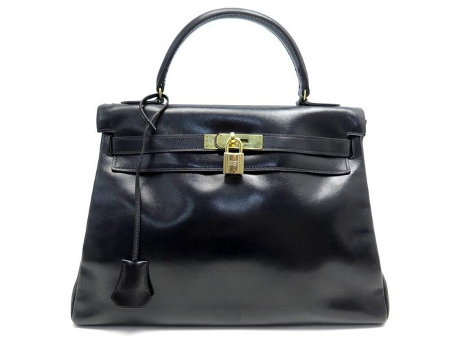 Hermès VINTAGE HERMES KELLY HANDBAG 33 Return 1970 BLACK LEATHER BOX HANDBAG  ref.330647