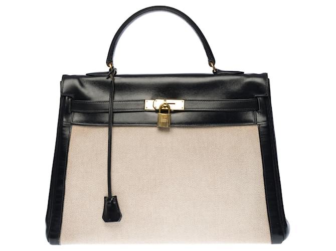 Hermès Stunning Hermes Kelly handbag 35 inverted cm in black box leather and beige canvas, garniture en métal doré  ref.341489