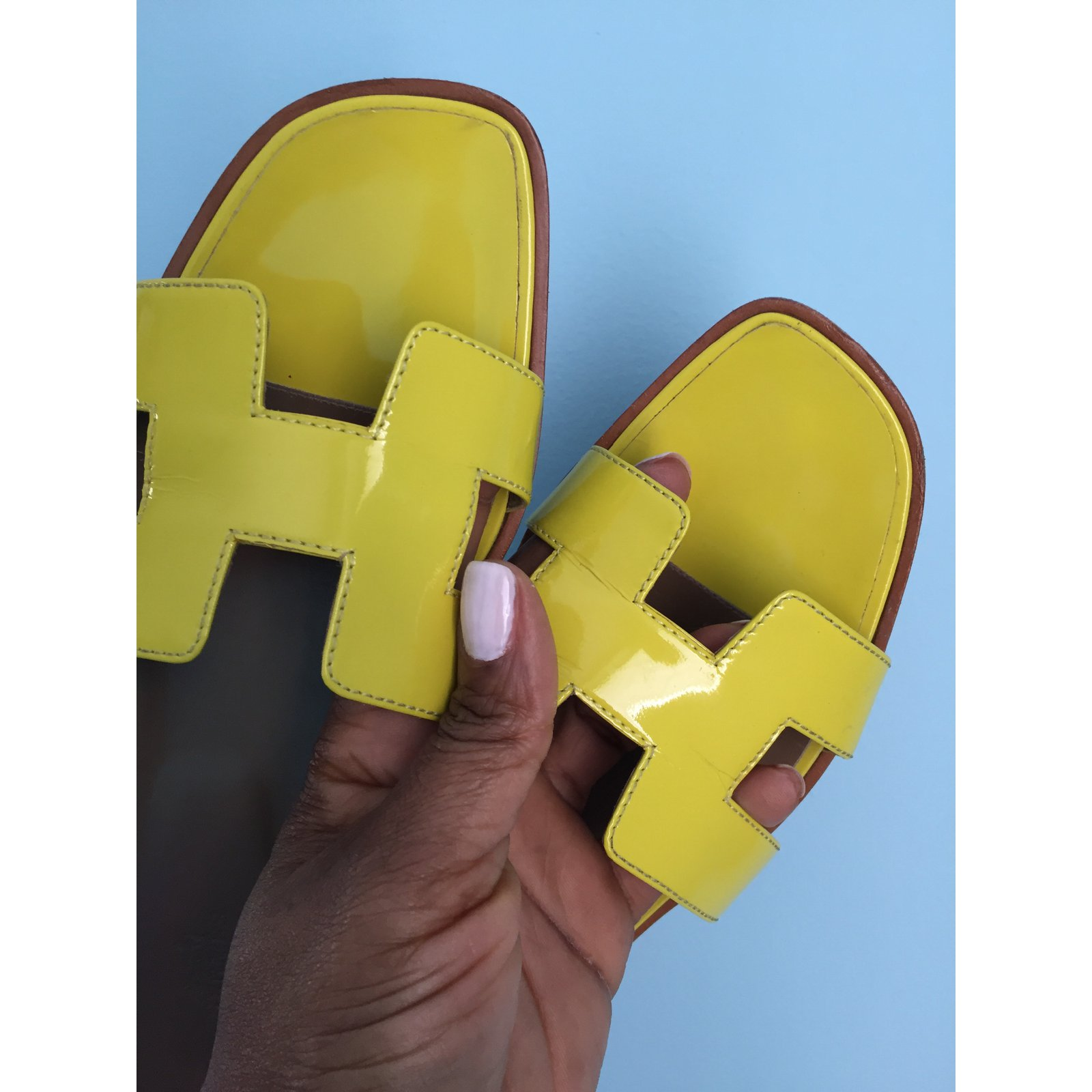 76b2e38ba1fc Facebook · Pin This. Hermès Oran Vernis fluo Sandals Patent leather Yellow  ...