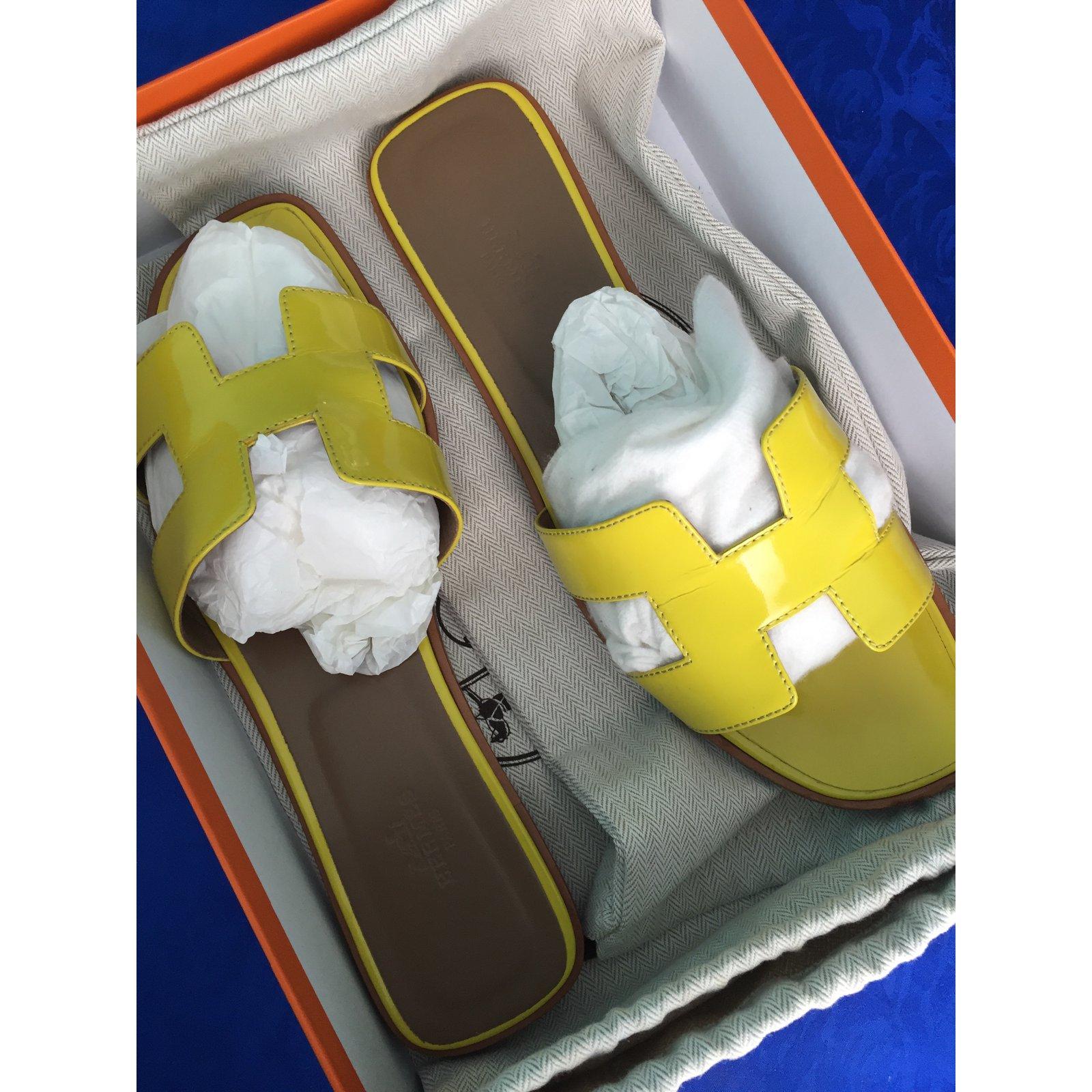 bab176d02178 Hermès Oran Vernis fluo Sandals Patent leather Yellow ref.16713 - Joli  Closet