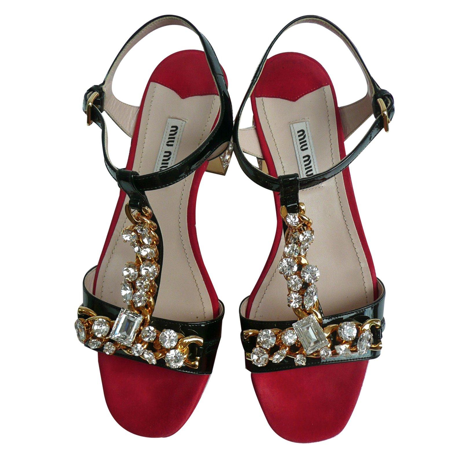 Sandales plates à fleursMiu Miu sRMck