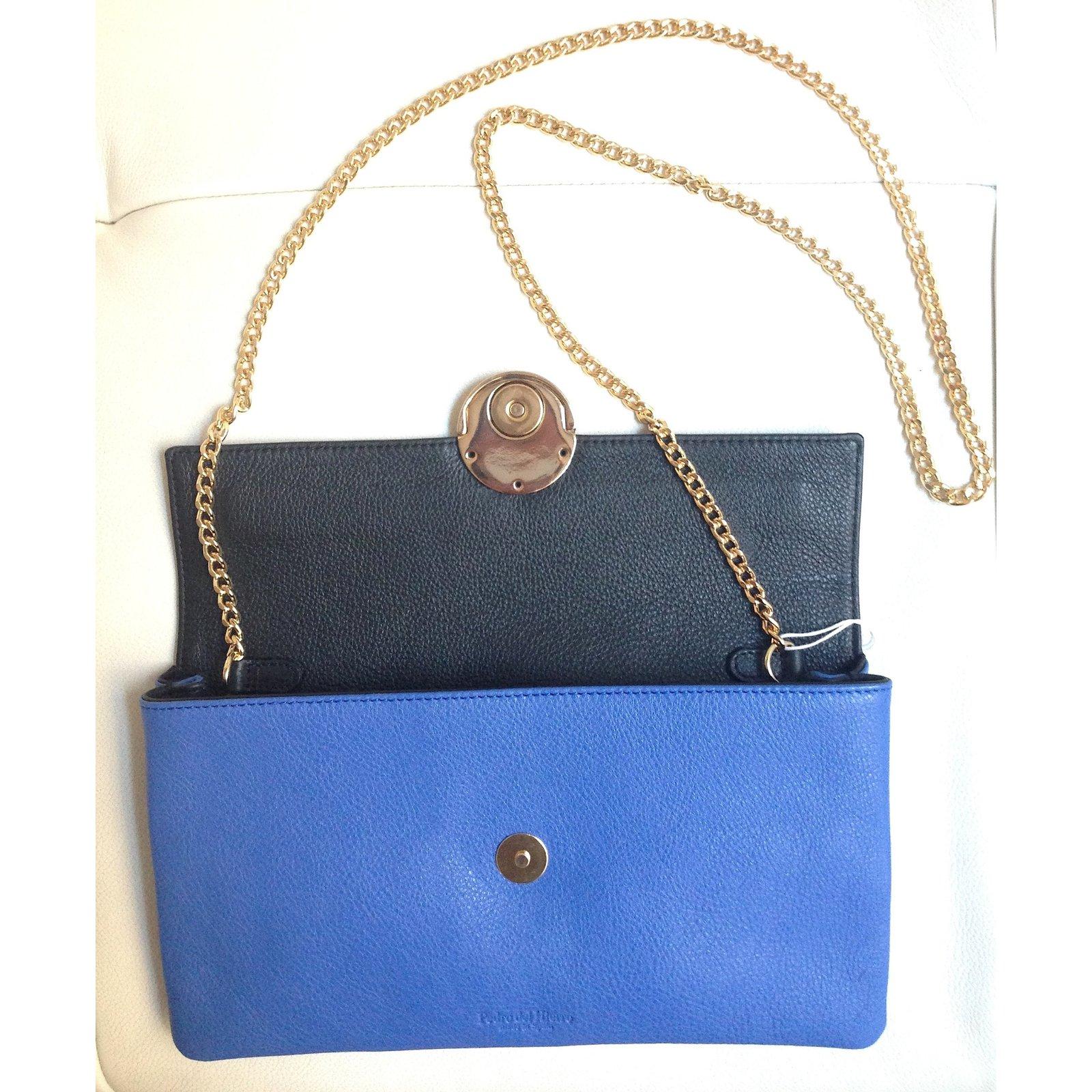 pochettes autre marque pochettes cuir d 39 agneau bleu joli closet. Black Bedroom Furniture Sets. Home Design Ideas