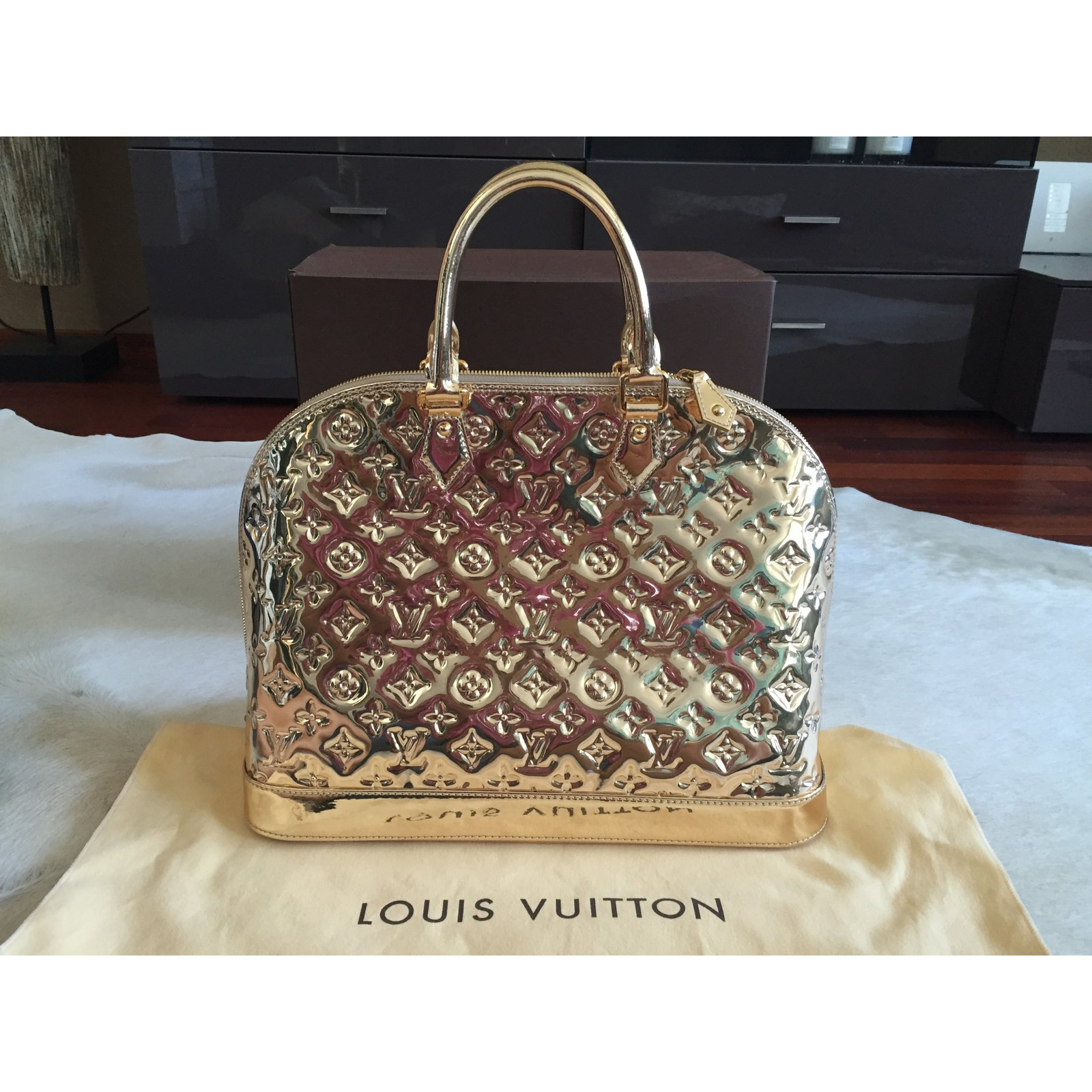 7c3c14acfeba Facebook · Pin This. Louis Vuitton ALMA MM MIROIR DORE GOLD - SPECIAL  EDITION Handbags Patent leather Golden ref.