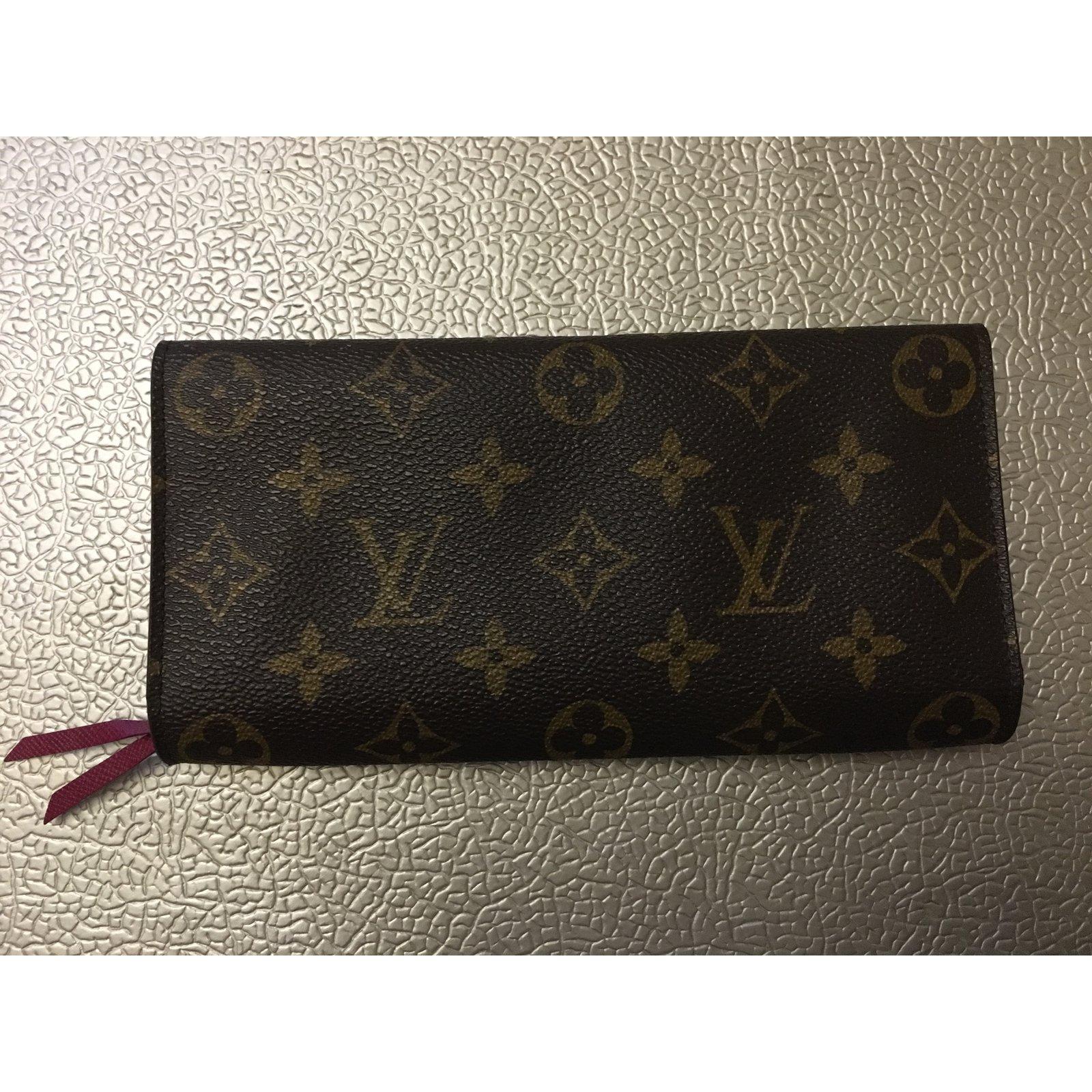 2f60a81f0a8 Facebook · Pin This. Portefeuilles Louis Vuitton portefeuille Monogramme  Louis Vuitton Emilie Wallet Fuchsia Toile Marron ...