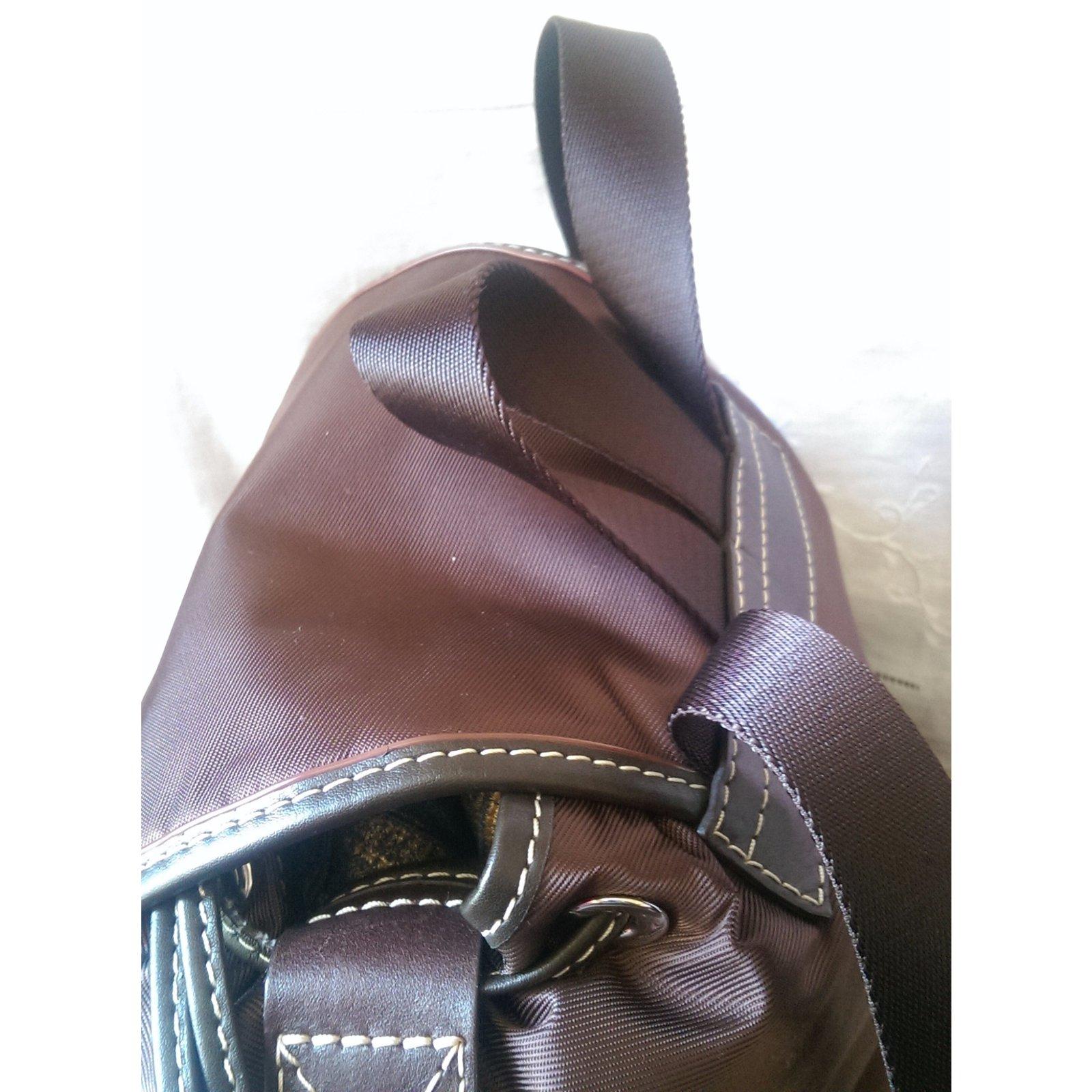sacs dos lancel sac dos cuir toile marron joli closet. Black Bedroom Furniture Sets. Home Design Ideas