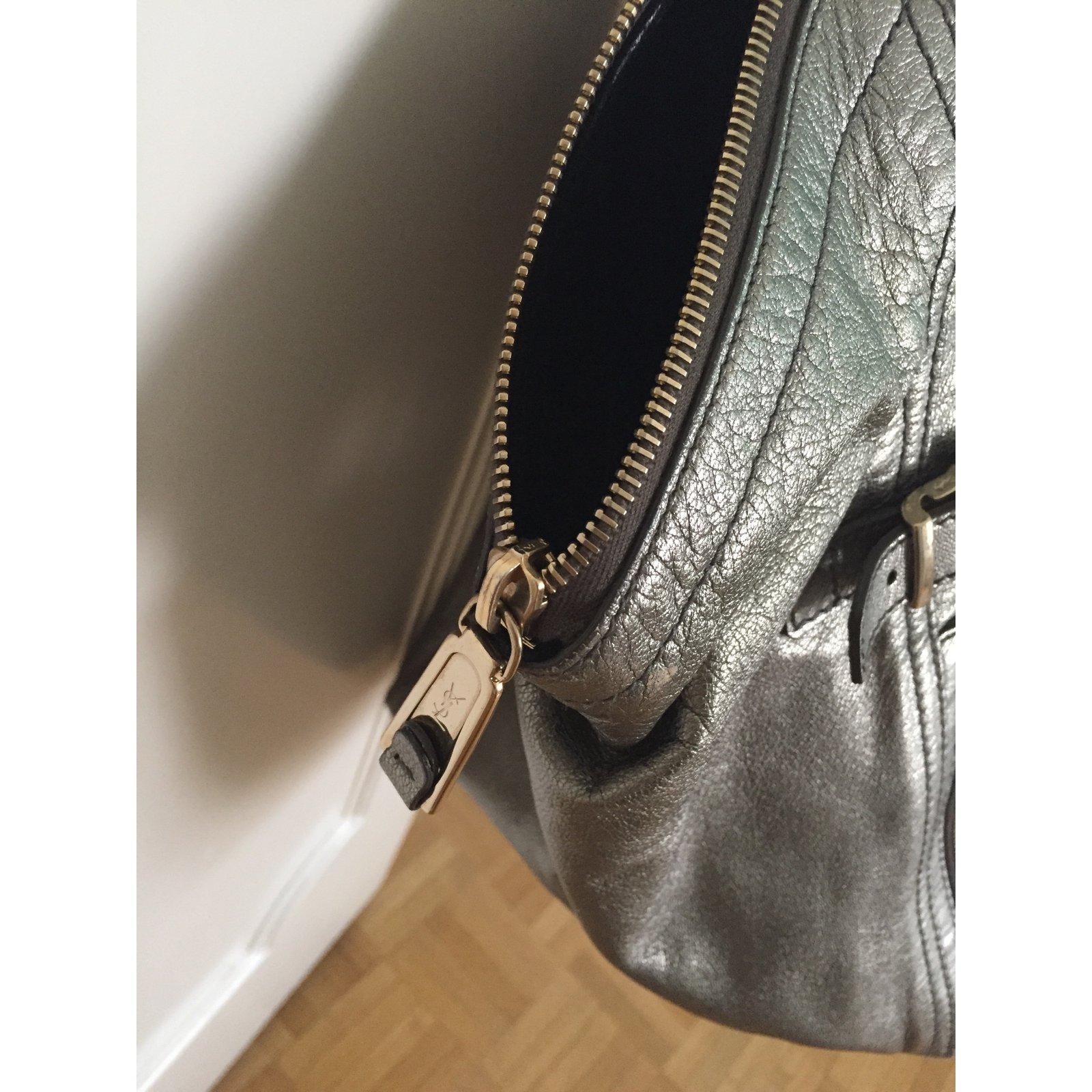 5905cf2123 Facebook · Pin This. Yves Saint Laurent Handbag Handbags Leather Silvery ref .41320