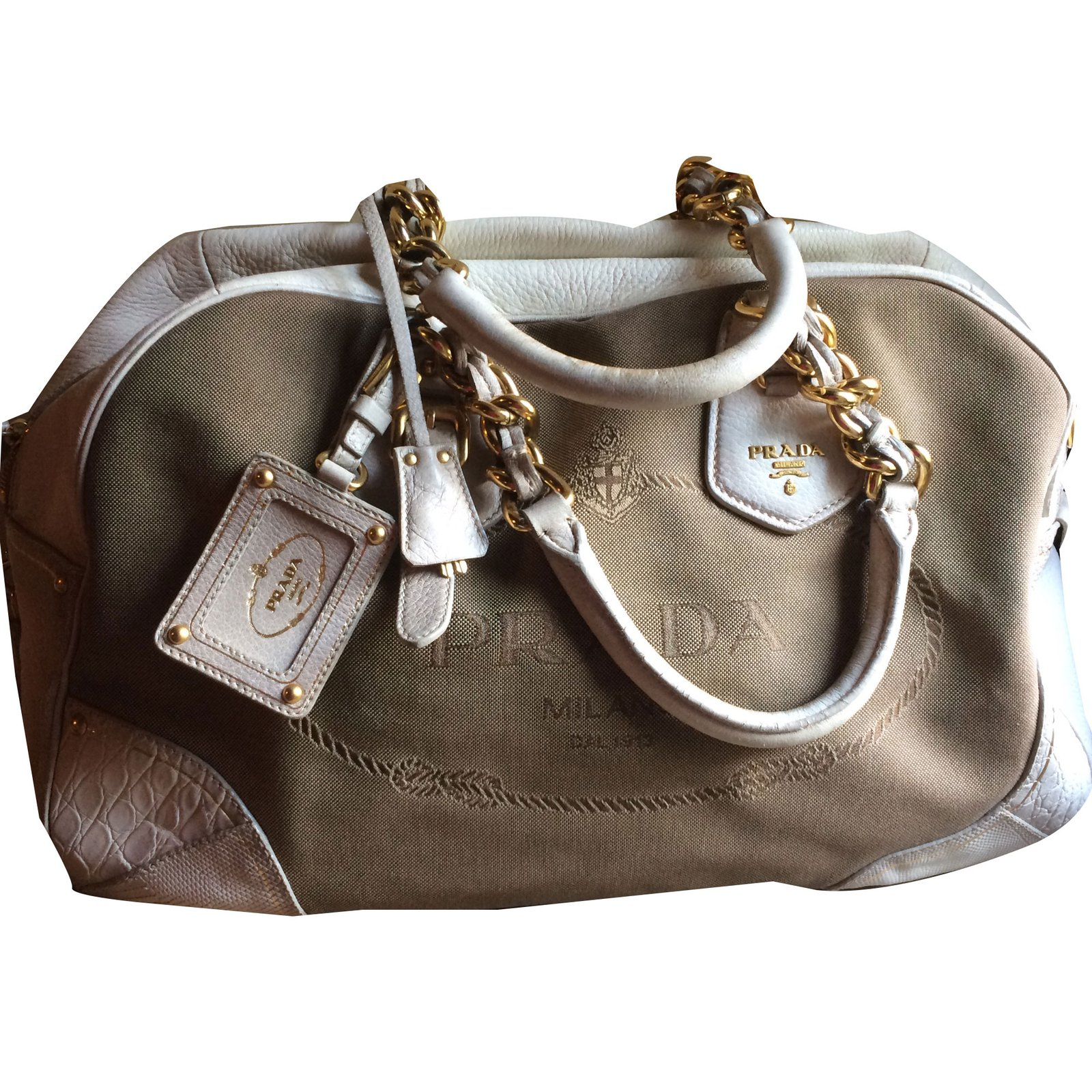 9c970a7ab7 Facebook · Pin This. Prada Handbags Handbags Cloth Beige ref.51775