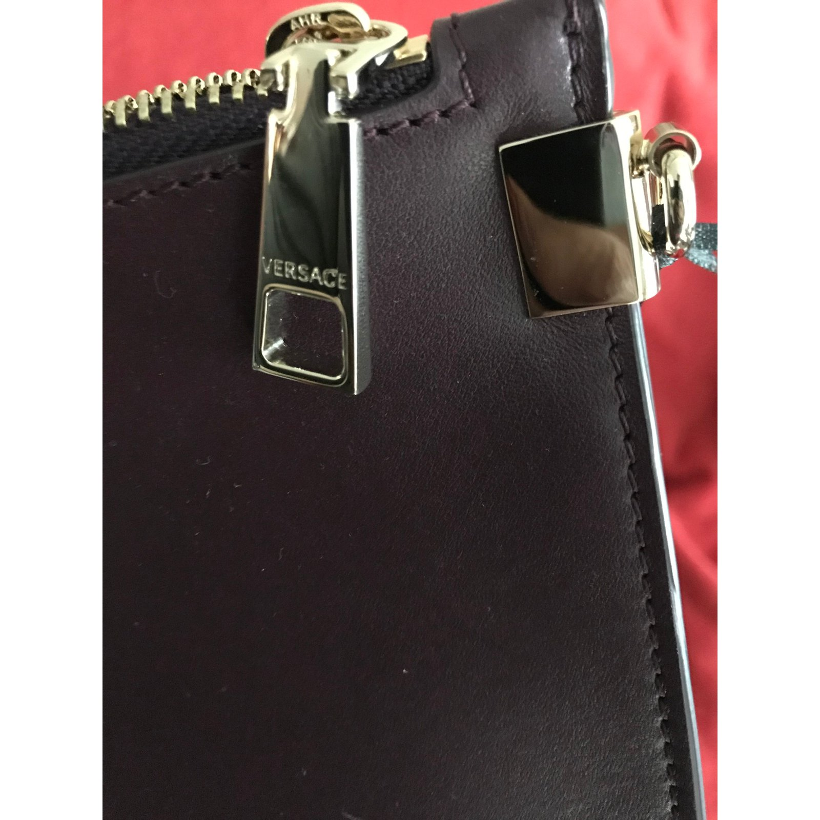 Facebook · Pin This. Gianni Versace VERSACE MEDUSA CALF LEATHER POUCH - burgungy  All new Handbags Leather Dark brown ref 6c6e36ddc1a86