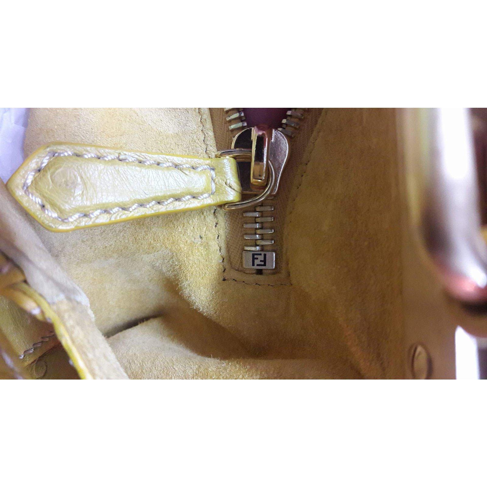 251fd2715d4e Fendi Ostrich Peekaboo Handbags Exotic leather Yellow ref.62950 - Joli  Closet
