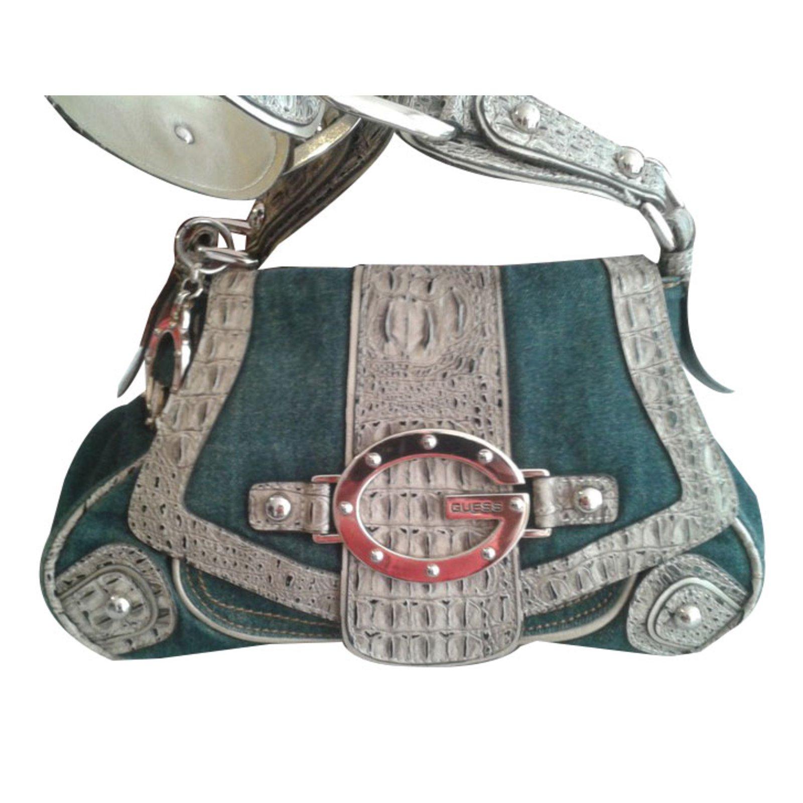 9a5b42f7c0dd Facebook · Pin This. Guess Handbags Handbags Cloth Blue ref.67484