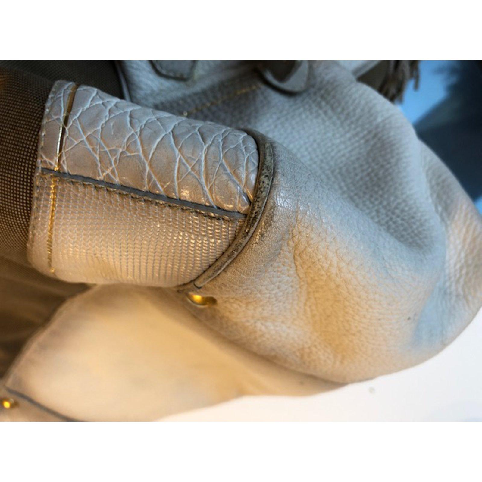 b5e9c95e43 Facebook · Pin This. Prada Handbags Handbags Cloth Beige ref.67874