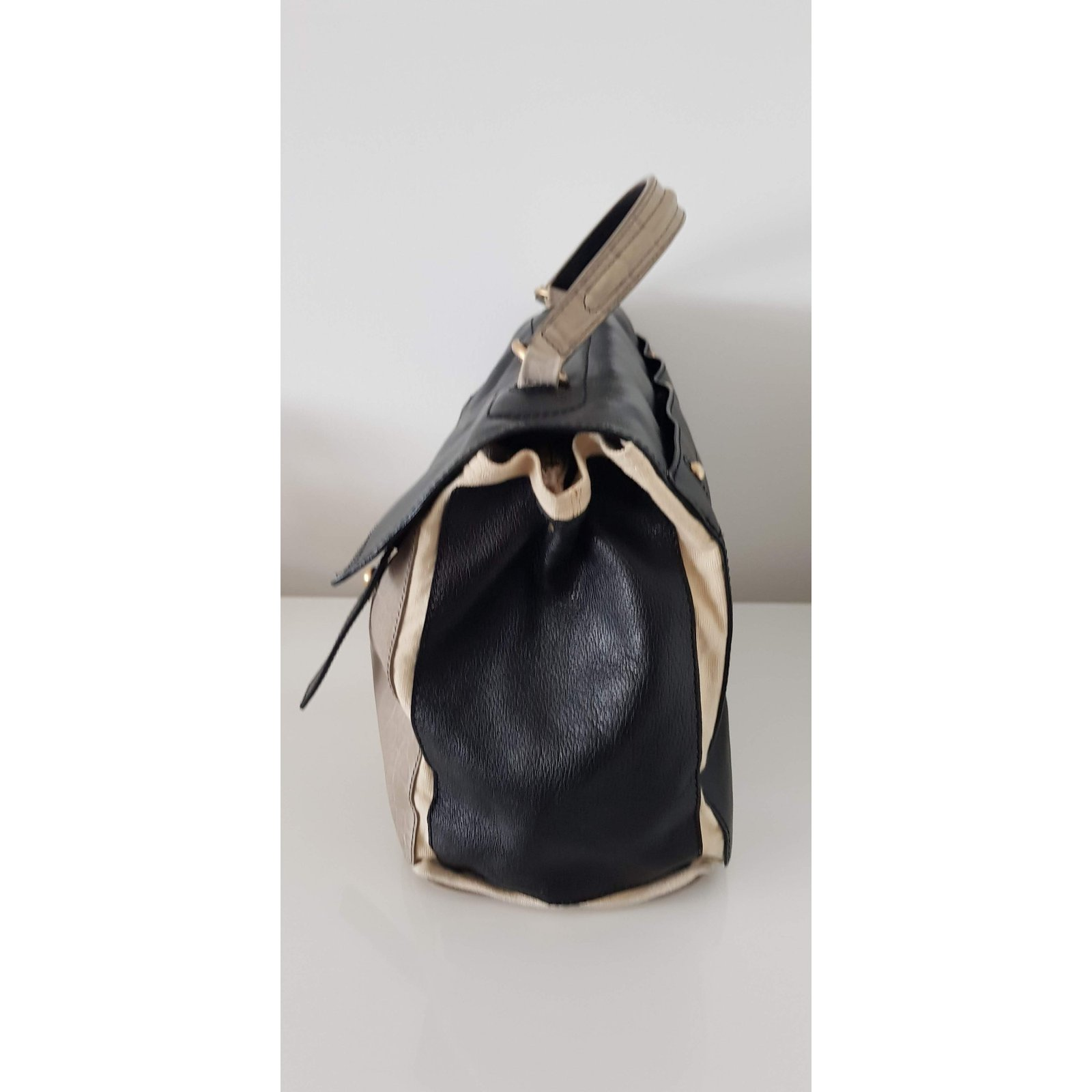 3492520e3d Facebook · Pin This. Yves Saint Laurent muse two large Handbags Leather