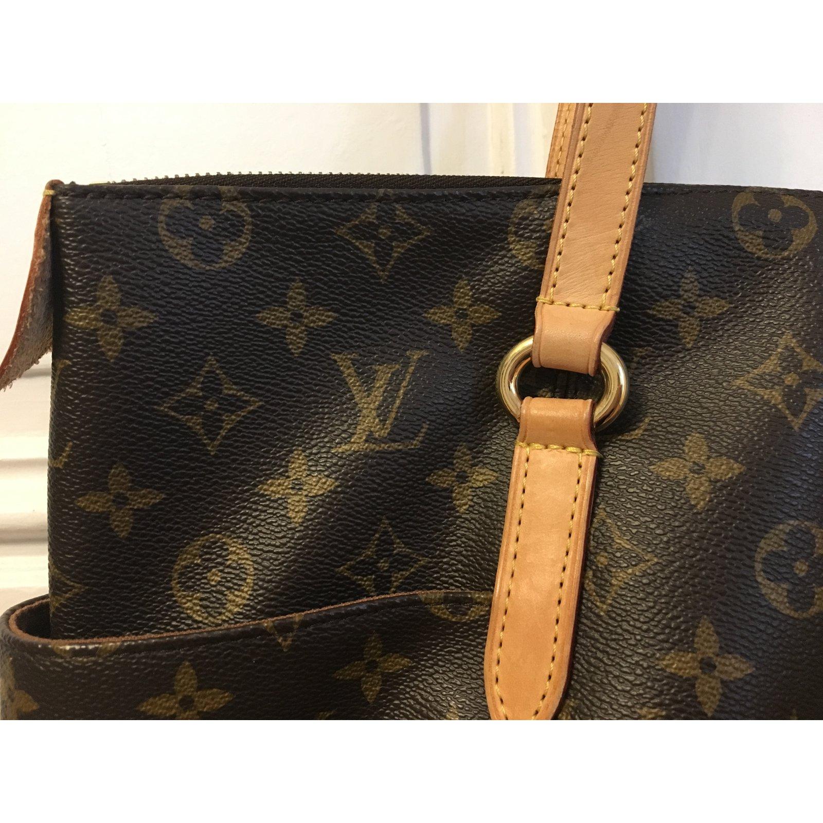 7024039ef0dd Sacs à main Louis Vuitton Totally MM Cuir