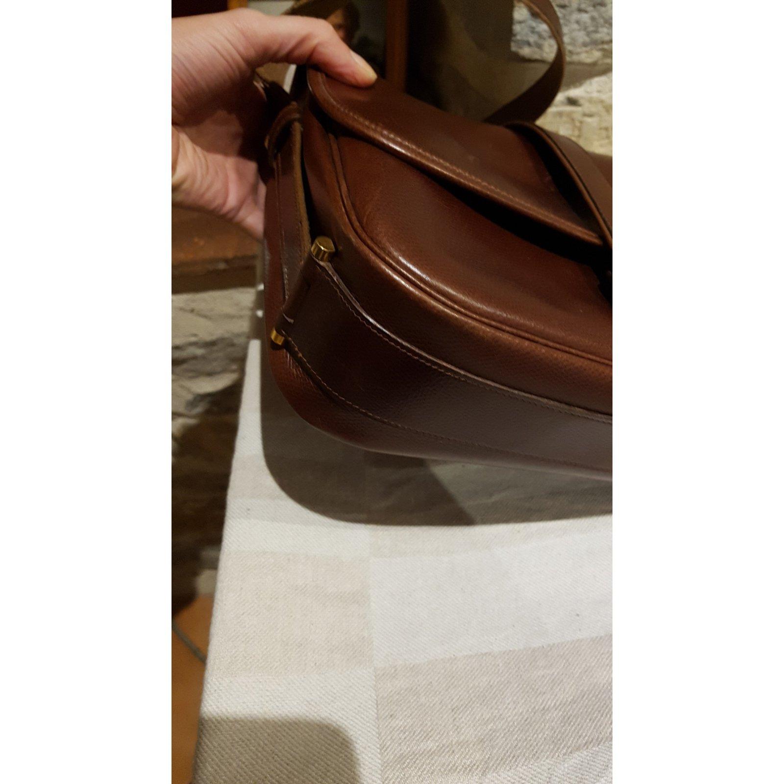 96594ca982e2 Facebook · Pin This. Hermès Nouméa leather bag courchevel chocolate  Handbags Leather Brown ...