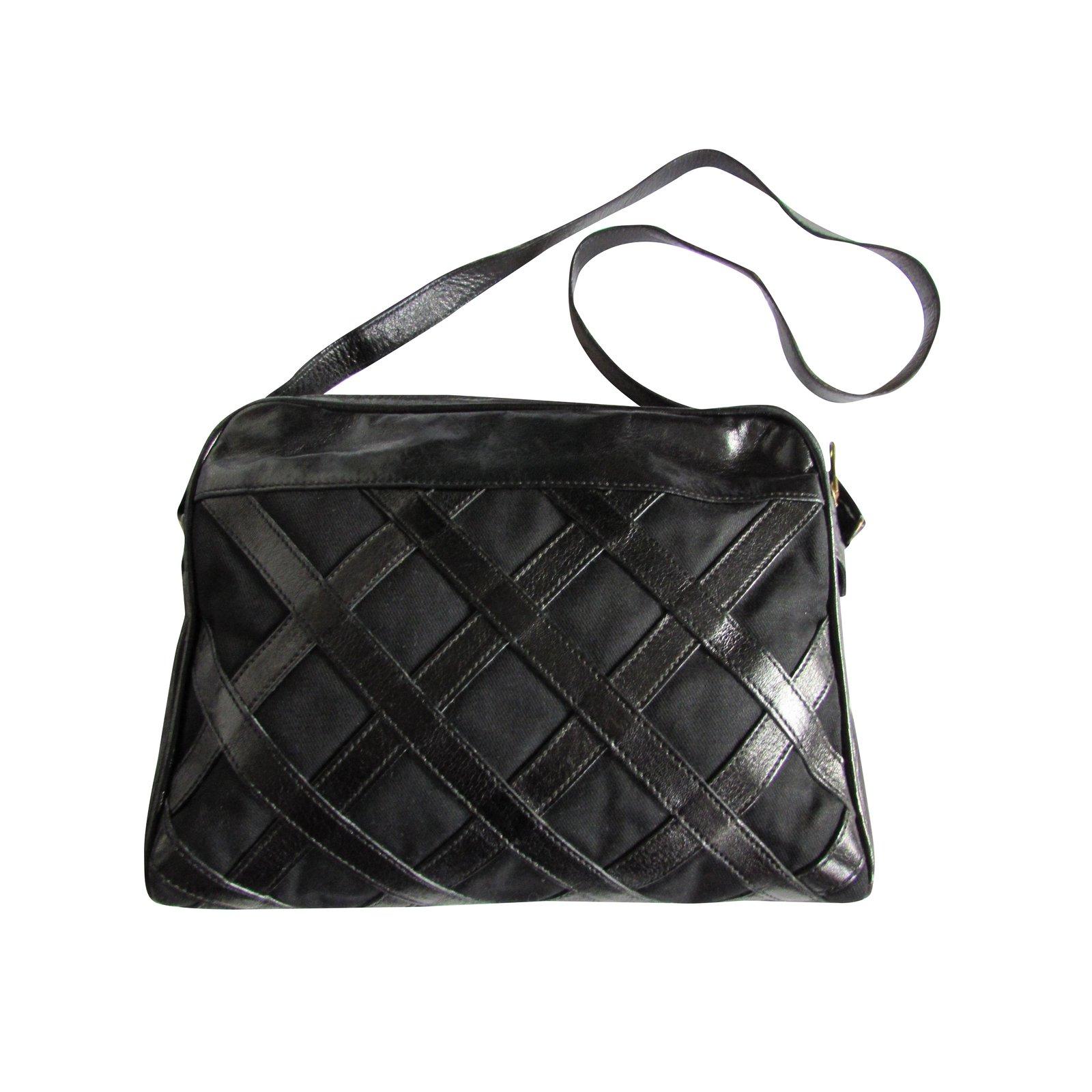 e1a225414fb Yves Saint Laurent Handbags Handbags Leather,Cloth Black ref.99125 - Joli  Closet