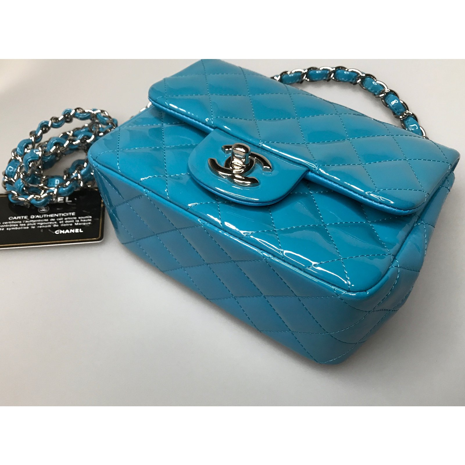 705a403583e5 Facebook · Pin This. Chanel With card! Mini square flap bag timeless  Handbags Patent leather Blue ...