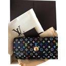 Bourses, portefeuilles, cas - Louis Vuitton