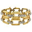 Bracelet articulé or jaune et blanc, diamants. - inconnue