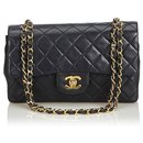 Chanel Black Classic Small Lambskin Leather lined Flap Bag