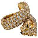 """Bague Cartier """"Panthère de Cartier"""" en or jaune, diamants, émeraudes et onyx."""