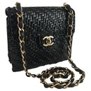 BLACK COATED WICKER FLAP MINI BAG - Chanel