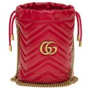 Gucci Mini bucket GG Marmont bag in red herringbone leather, new condition