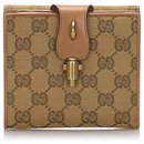 Gucci Brown GG Canvas Bi-Fold Wallet