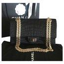 Chanel black satin reissue flap bag