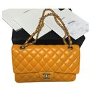 Chanel Yellow lambskin classic medium flap bag