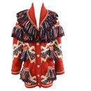 célèbre manteau à franges de Dallas - Chanel