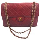 Chanel Timeless lined sided bag in red quilted lambskin.